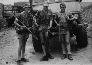 I'm at left in the photograph below. This was toward the end of my service in January 1977, and we had just gotten back from a four-day patrol in the operational area. This was in mid-1976 and was the first landmine incident I saw in person. I did not have a camera, so I tore the cover off the logbook of the truck in the bottom sketch and sat there and drew this quickly with a ballpoint pen. There were two trucks involved and some troops injured.