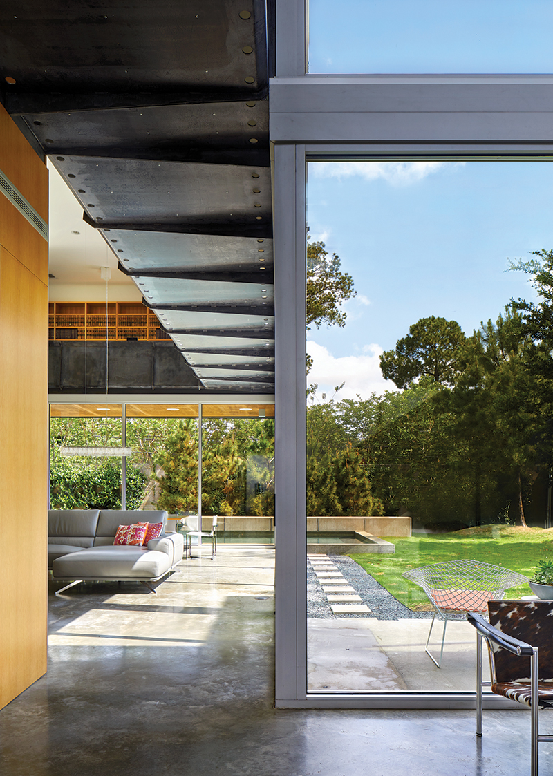 Meadow Lake_Dror - Interior view of folded steel plate catwalk system from gallery looking to living room