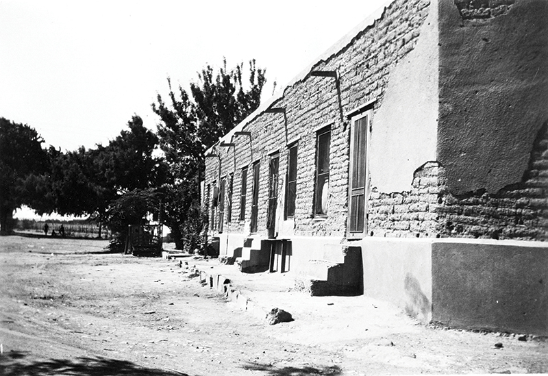 Fred Morales and El Paso Times. View of Adobe Tenement. copy
